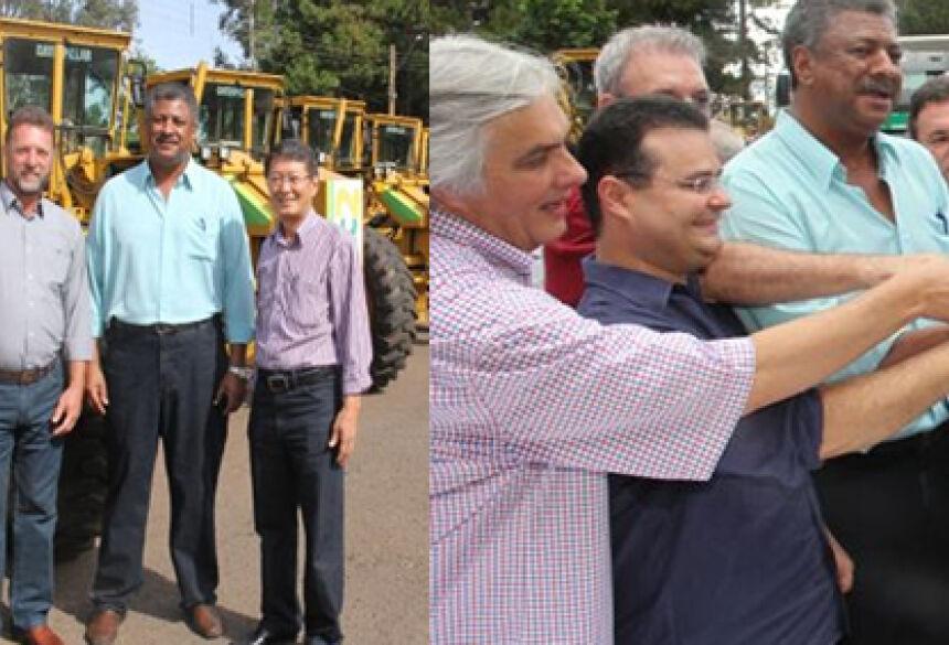 Prefeito de Vicentina Hélio Sato e vice Valter Dalla e Prefeito de Jateí Arilson Targino recebendo motonivelarora