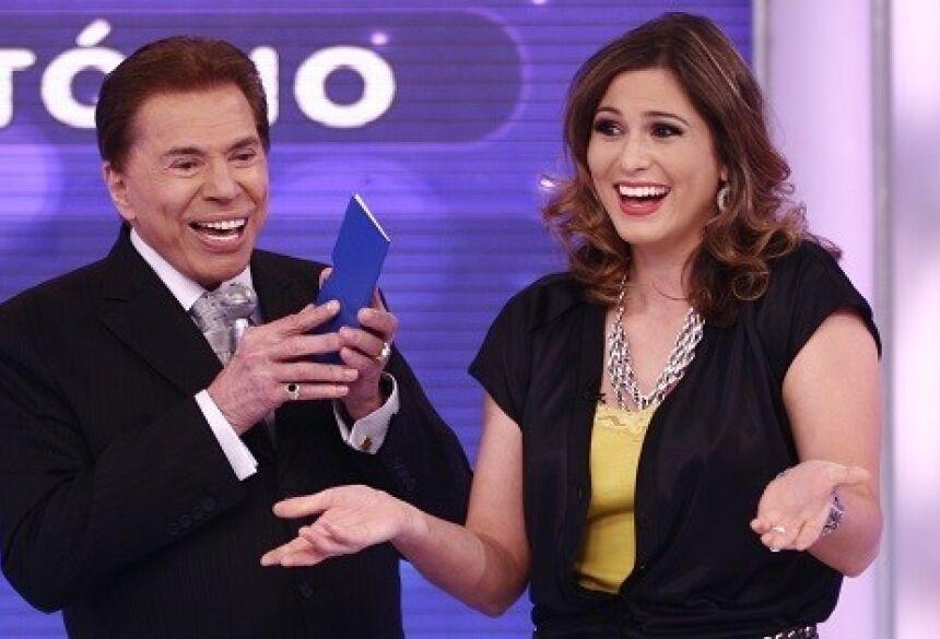 O apresentador Silvio Santos e Lívia Andrade; dono do SBT sugeriu que colega faz sexo para emagrecer (Foto:Roberto Neman)is/SBT