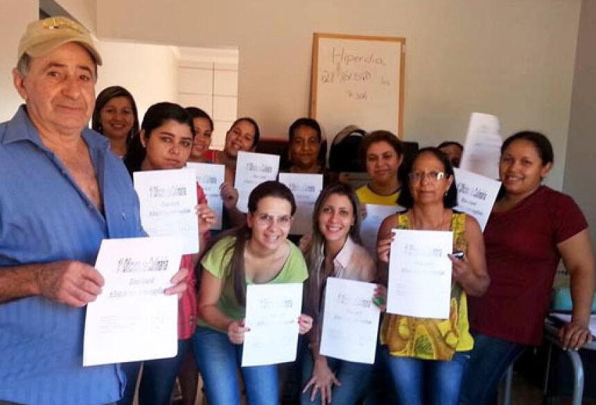 Grupo da Estratégia de Saúde da Família no Jardim Brasilândia durante Oficina de Culinária.